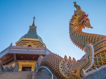 Photo of Naga statue on blue skies background