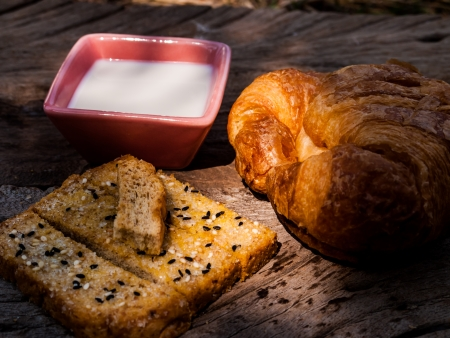 photo of Freshly toasted salt and sesame bread and  croissant photo