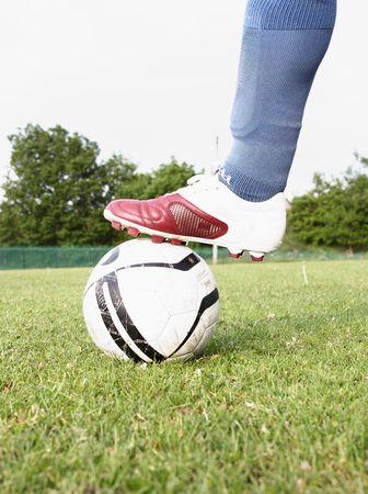 Footballer stopping a ball Stock Photo
