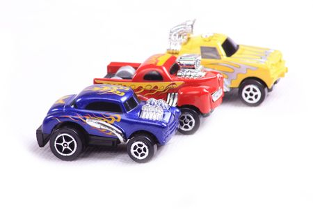 3 toy cars racing