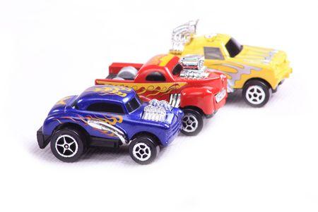 3 toy cars racing photo