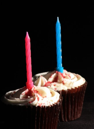 two cakes with a candle in each of them
