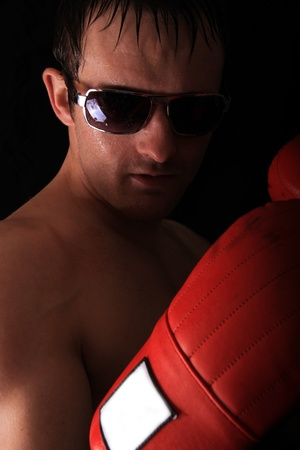model with red boxing glove looking at the camera Stock Photo