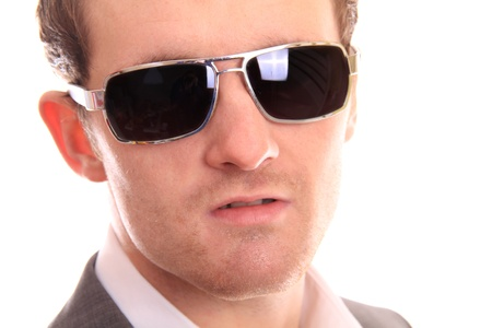 serious close up of a business man against a white background photo