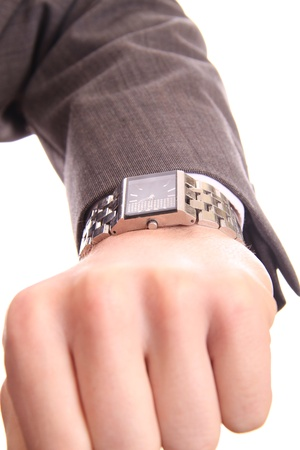 business man checking his watch to know the time on a white background photo