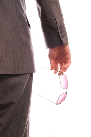 man standing on white background holding a pair of glasses Stock Photo - 8700243