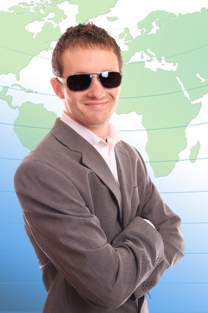 business man standing against a world background. portrays an eco friendly or a care for the environment photo