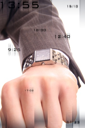 man looking at his watch with numbers flowing around the image. photo