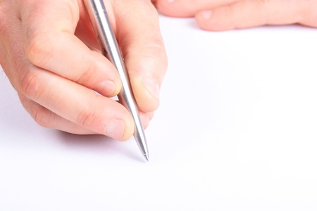 hand with a pen writing on white paper. ideal for copy space