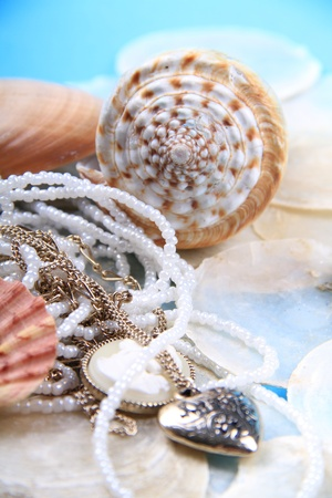 washed out: shells and pearl jewellery together with a nice blue washed out colour