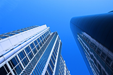 wide angle shot of 2 buildings from the city scene, image has added blue filter effect for amore blue,crisp,clean look.