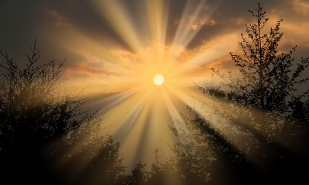 silouette: image of a bright sun bursting throught the sky with big sun rays Stock Photo