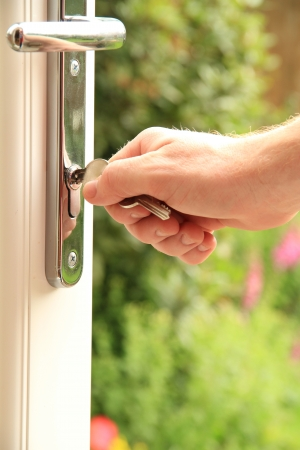 a man holding onto a set of keys for a new door photo