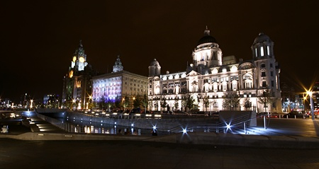 wide angle night shot of the liverpool dock front. Liver building and the customs building is beautifully lit up at night. no property release required.
