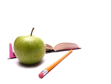 image shows an apple for a snack to take a break from studying. Apple is the main focus with the addition of a pencil and a book in the background. photo