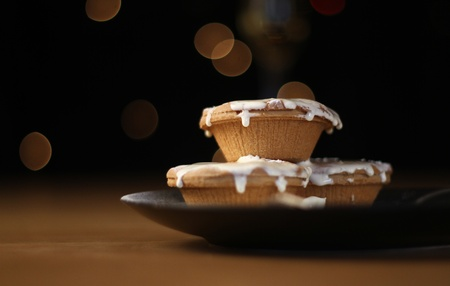 Christmas mince pies and cream with blurred fairy lights behind. A traditional treat for Santa! shot at very low aperature.  photo