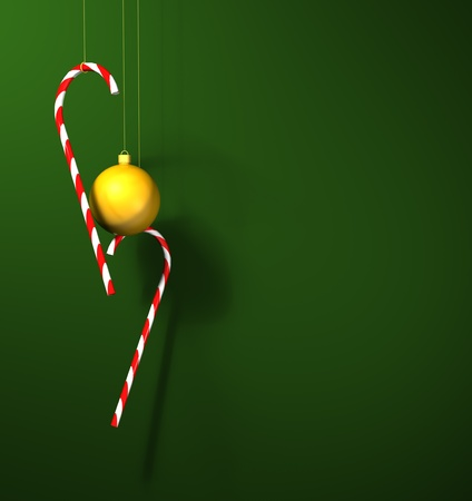 a gold 3D bauble with two christmas candy canes against a green background ready for christmas Stock Photo - 11662245