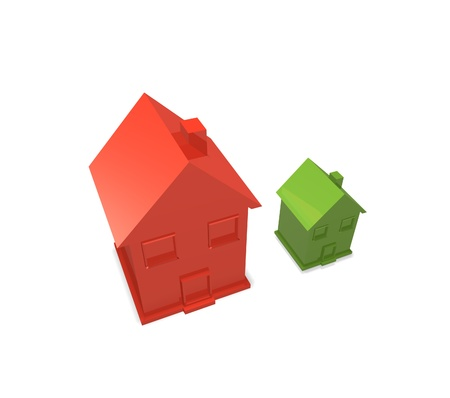 a big red house and a small green house stand next to each other for comparison of size Stock Photo