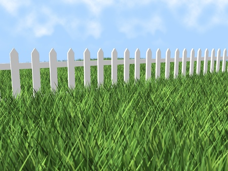 an image of a white picket fence through a field of grass with a bright blue sky. photo