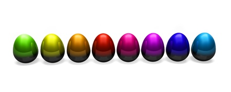 many small multicoloured easter eggs in a row on a white background