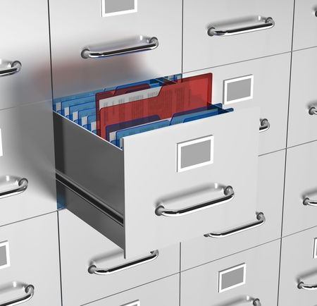 a file drawer is open with office documents on show with a reddocument being selected  Stock Photo