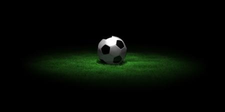 a 3D scene with a soccer ball on green grass in the dark Stock Photo - 13766243