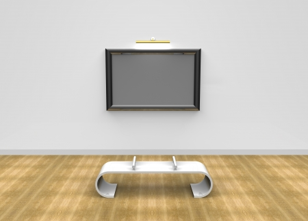 Blank photo frame at the wall in a museum with a bench in front on wooden flooring  photo