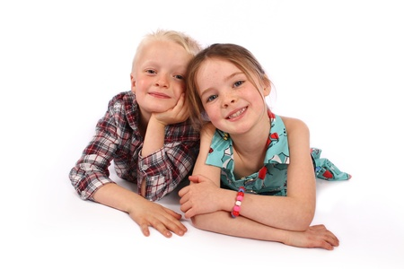 brother and sister pose for a photo together on a white background  Stock Photo