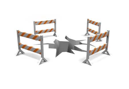construction barriers surround a crack in the ground as a warning