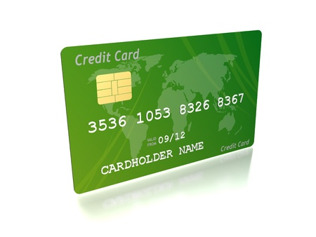 a green credit card against a white background  photo