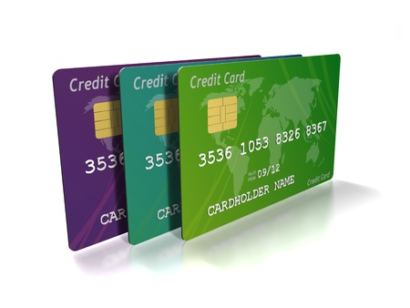 3 credit cards together in green ,blue and purple, standing upright on a white  Stock Photo - 16979772
