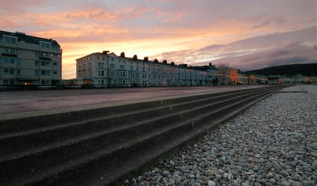 a shot of the steps leading down to the beach in Llandudno at sunset