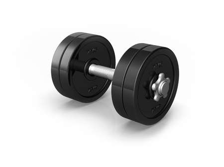 A heavy black dumbell sits on a white background with a shadow and reflection photo