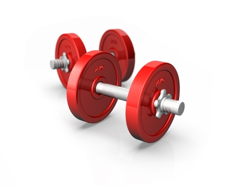 Two red dumbells sit on a white background with a depth of field added to the image photo
