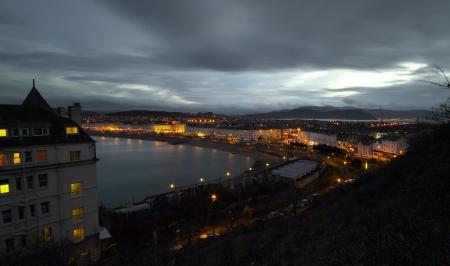 a night shot of llandudno seaside town in wales in the uk Stock Photo