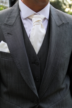 close up image of person wearing a suite focusing on the tie and colller area  photo