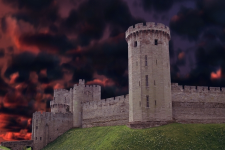 Tall dark Castle from England with a mysterious dark clouds behind it  Editorial