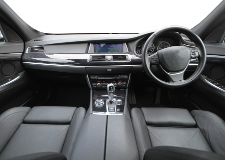 drivers seat: And detailed wide shot showing the inside of a high class car with white background for the windows   Stock Photo