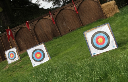 Three targets lined up at different distances at an archery range  Stock Photo