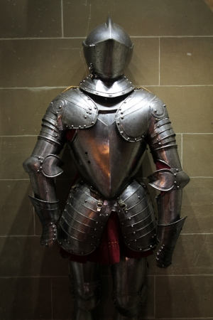 Kings armor in the spotlight in a museum Stock Photo