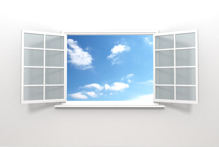 A beautiful view from an open window inside a house showing a scenic cloud scape outside. Stock Photo