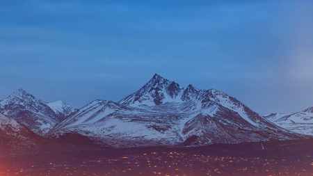 anchorage: High white mountain of Anchorage, downtown, twilight
