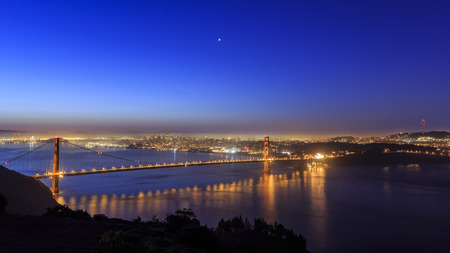 Golden Gate Bridge, SFO at night with a starry sky Stock Photo