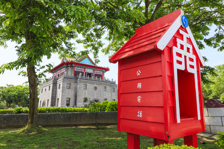 Speical style phoning machine with Juguang Tower behind