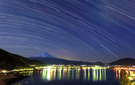 star trail: The famous Mt. Fuji with star trail at Kawaguchi, Japan Stock Photo