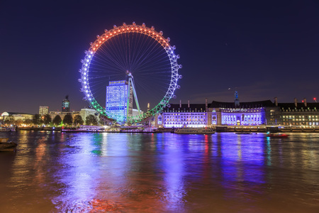 historical reflections: Traveling in the famous London Eye, London, United Kingdom around twilight Editorial