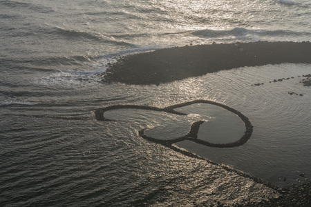 The DOUBLE-HEART STONE TRAP in the Penghu island of Taiwan Stock Photo