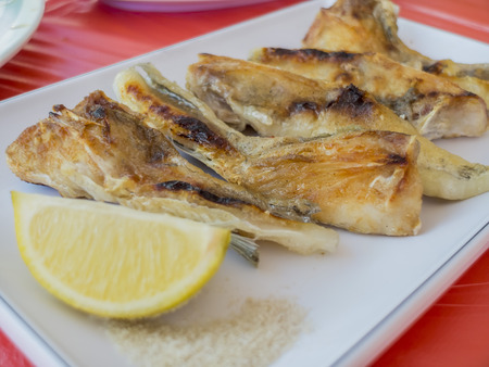 Delicious grill fish chin with lemon and salt 스톡 콘텐츠
