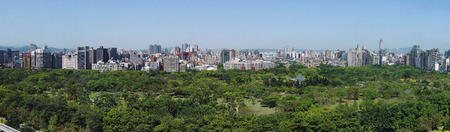 Aerial view of Daan Forest Park and Taipei cityscape around afternoon 스톡 콘텐츠
