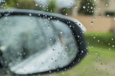 dismal: water drops on car window